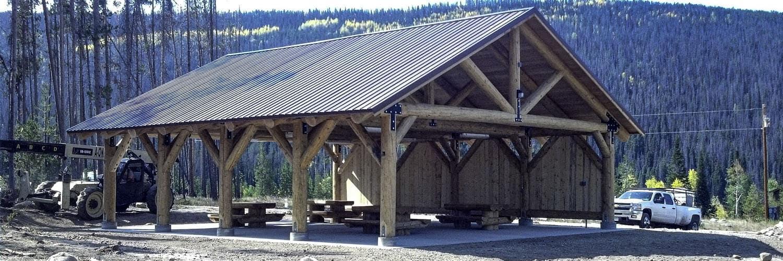 Large Log Pavilion with Back Board