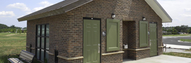 Brick Exterior Restroom Building with Green Accessories