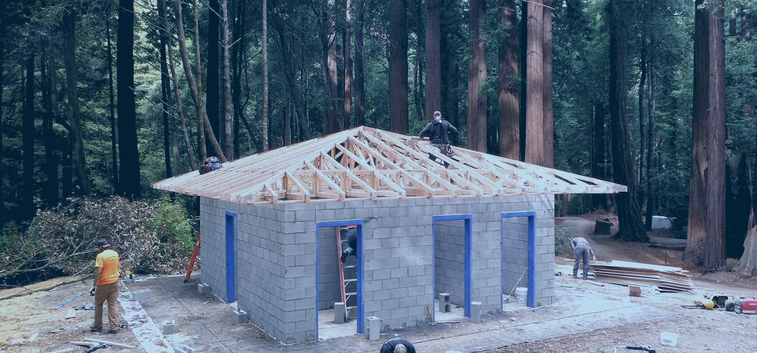 Custom Square Restroom Building in Wooded Area