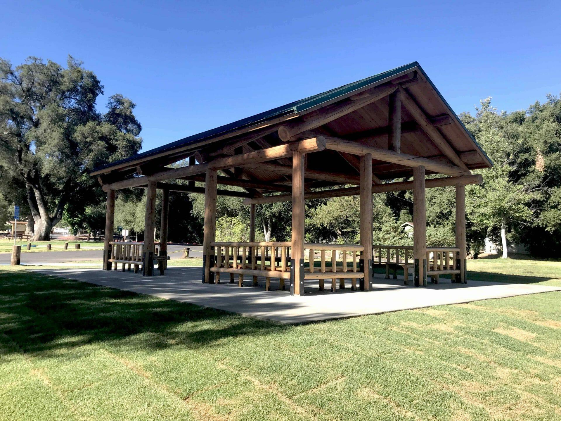 Large Log Pavilion with Side Railing